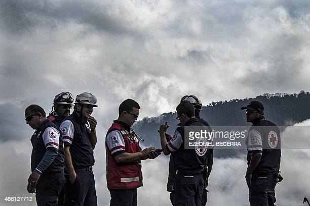 Members of the Costa Rican Red Cross check the quality of the air near the Turrialba volcano in San Gerardo de Irazu 65 km northeast of the San Jose...