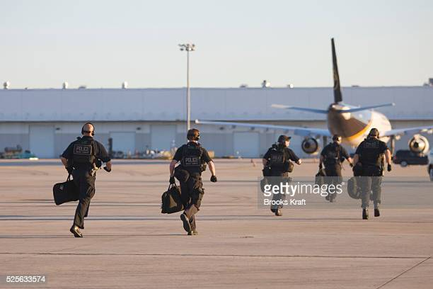 Members of the Counter Assault and Tactical Division of the Secret Service run to position after getting off a helicopter in Houston as they follow...