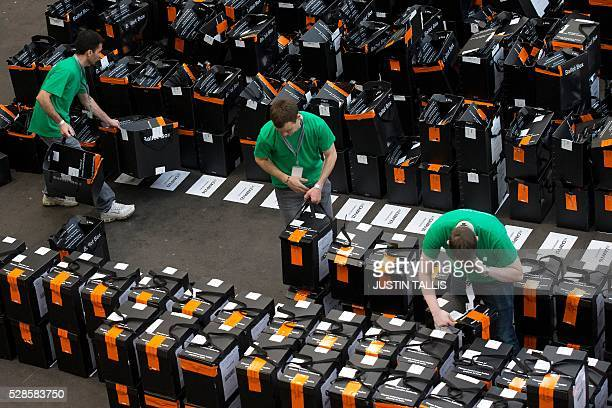 Members of the counting staff sort through sealed and unsealed ballot boxes at a count centre in north London on May 6 2016 Early results Friday from...