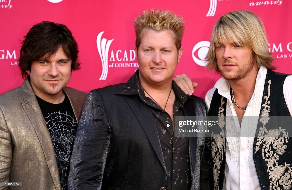 Members of the country band Rascal Flatts (L-R) Jay DeMarcus, Gary LeVox and Joe Don Rooney arrives at the 41st Annual Academy Of Country Music Awards held at the MGM Grand Garden Arena on May 23, 2006 in Las Vegas, Nevada.