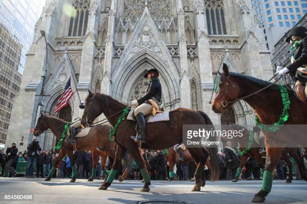 Members of the County Carlow Association ride horses as they march past St Patrick's Cathedral on 5th Avenue during the annual St Patrick's Day...
