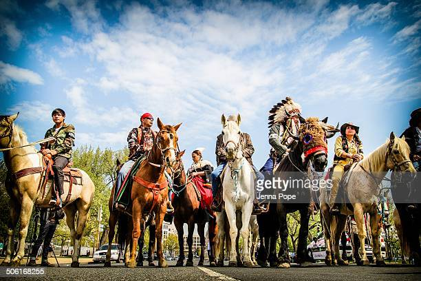 CONTENT] Members of the Cowboy Indian Alliance on horseback during the opening ceremony for the Reject and Protect actions against the Keystone...