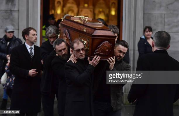 Members of The Cranberries Fergal Lawler Noel Hogan and Mike Hogan help carry Dolores O'Riordan's coffin from St Joseph's church on January 21 2018...