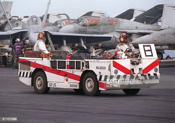 Members Of The Crash And Salvage Team Stand By In Case Of Emergency On The Flight Deck. USS Carl Vinson And Its Embarked Carrier Air Wing Is...