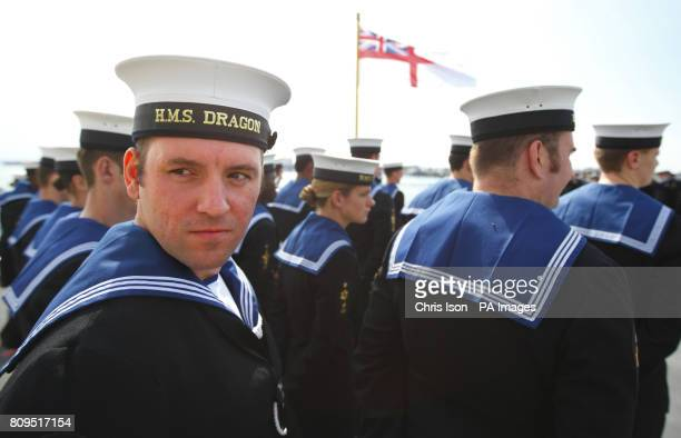 Members of the crew aboard the Royal Navy's newest warship the Type 45 Destroyer HMS Dragon as she is handed over to the Royal Navy from the builders...