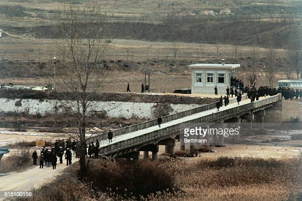 Members of the crew of the intelligence ship Pueblo cross the Bridge of No Return on their release by North Korean Communists after eleven months in...