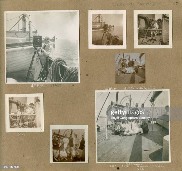 Members of the crew using a camera From an album collated by Aubrey Ninnis member of the 'Ross Sea Party' crew These photographs show members of the...