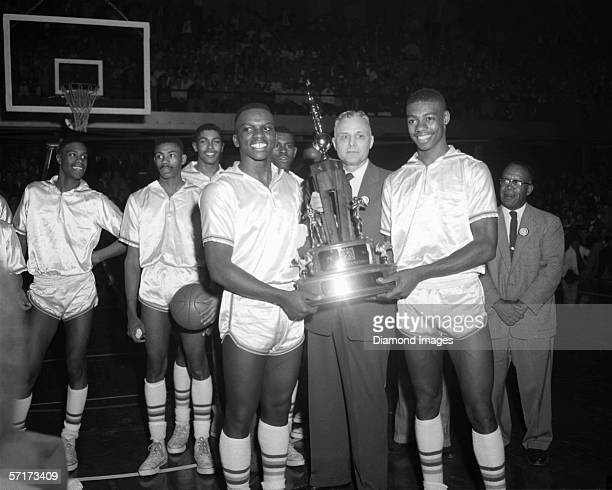 Members of the Crispus Attucks Tigers accept the 1956 Indiana State High School Boys Basketball Championship trophy after the game in March 1956...