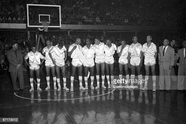 Members of the Crispus Attucks Tigers line up to accept the 1956 Indiana State High School Boys Basketball Championship trophy after the game in...