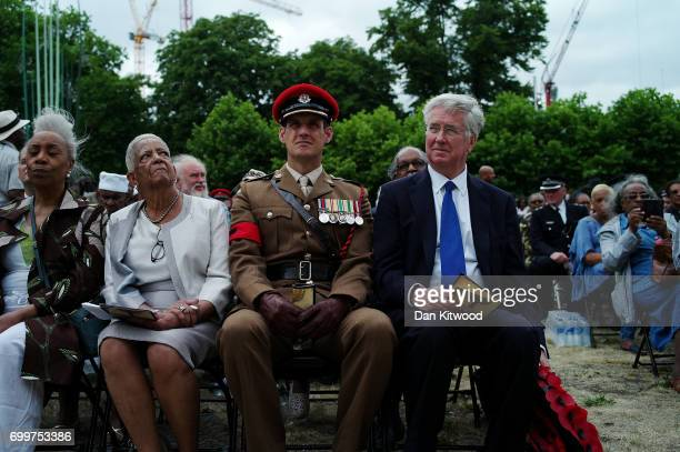 Members of the crowd and dignitaries including the Secretary of State for Defence Sir Michael Fallon watch as a memorial honoring the two million...