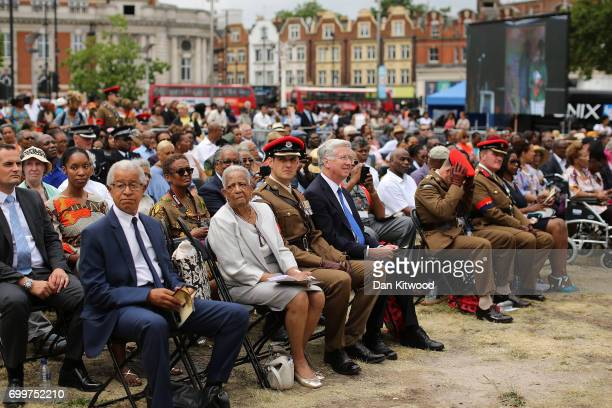 Members of the crowd and dignitaries watch as a memorial honoring the two million African and Caribbean military servicemen and women who served in...
