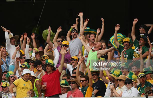 Members of the crowd celebrate after a wicket during day two of the First Ashes Test match between Australia and England at The Gabba on November 22...