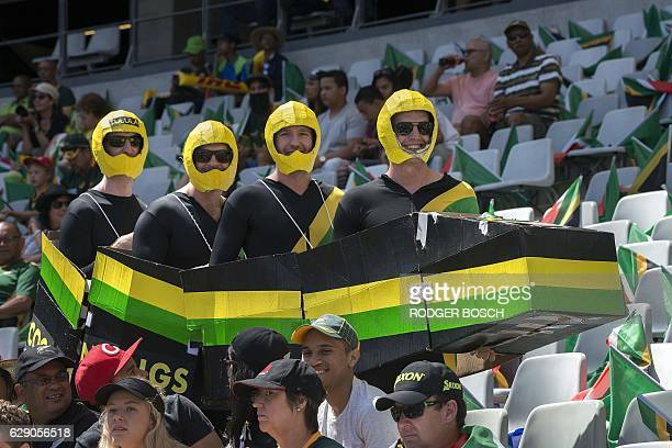 Members of the crowd dressed as a bobsleigh team attend the World Sevens Cape Town leg rugby match between Japan and Argentina at the Cape Town...
