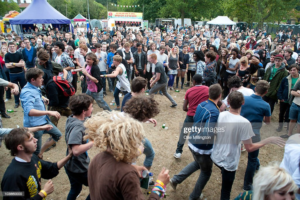 Members of the crowd encouraged by the band run around forming a 'circle-pit' as Pulled Apart By Horses perform on the main stage during the second and last day of Offset Festival at Hainault Country Park on September 5, 2010 in Chigwell, England.