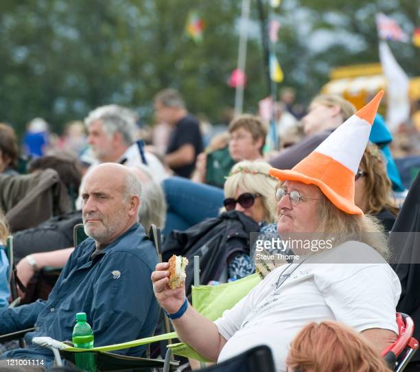 Members of the crowd enjoying Fairport's Cropredy Convention at Cropredy on August 12 2011 in Banbury United Kingdom