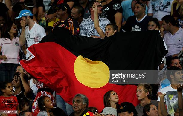 Members of the crowd hold up an Aboriginal flag during the Indigenous All Stars and the NRL All Stars match at Skilled Park on February 13 2010 on...