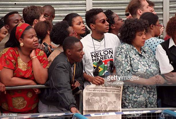 Members Of The Crowd Wait For Nelson Mandela In Brixton