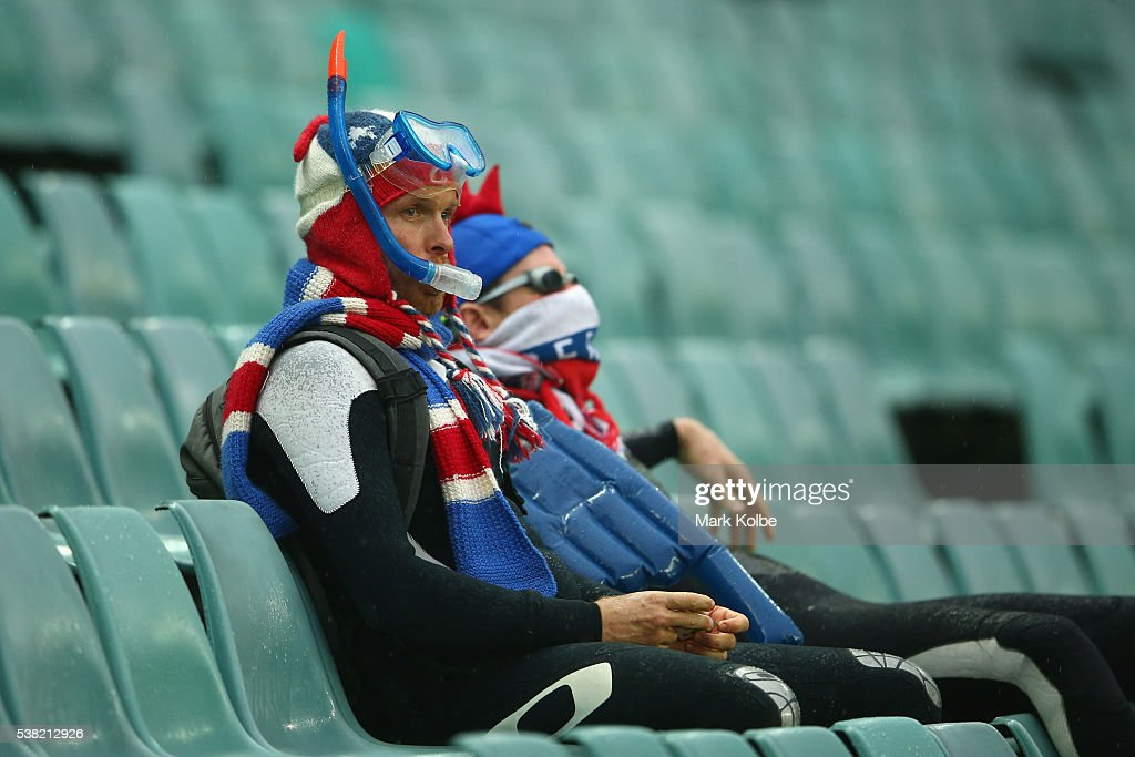 Members of the crowd watch on wearing snorkling gear during the round 13 NRL match between the Sydney Roosters and the Wests Tigers at Allianz Stadium on June 5, 2016 in Sydney, Australia.