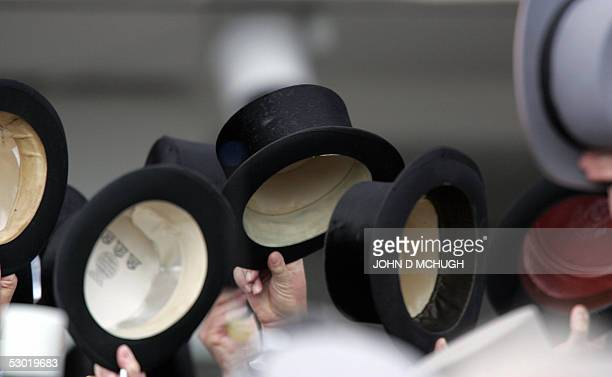 Members of the crowd wave top hats and cheer for Irish jockey Johnny Murtagh after he won the Derby on Motivator, owned by The Royal Ascot Racing...