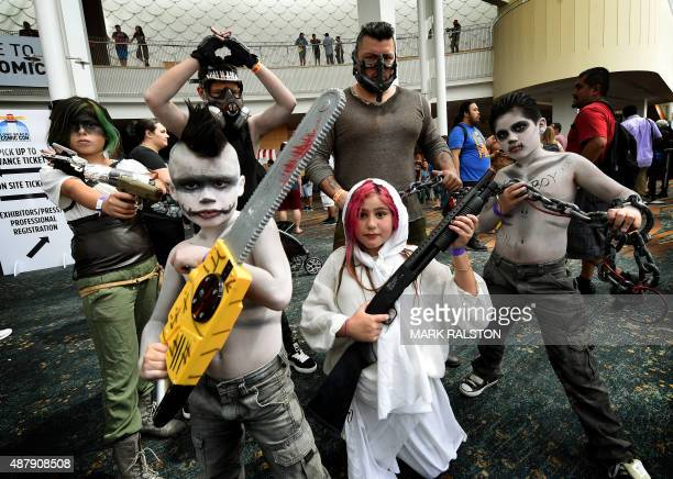 Members of the Cruz family pose in their Cosplay outfits before entering the twoday Long Beach Comic Con event at the Convention Center in Long Beach...