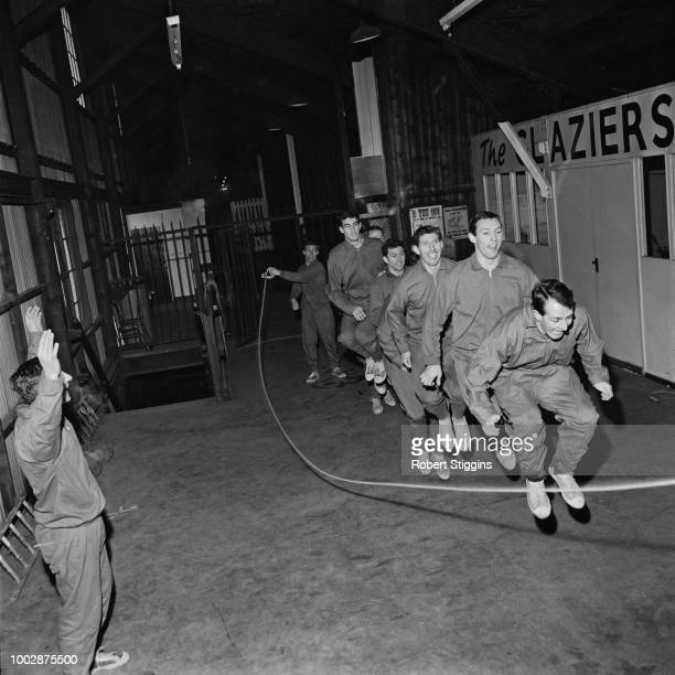 Members of the Crystal Palace FC team squad use a skipping rope as manager Dick Graham issues instructions during a fitness training routine at the...