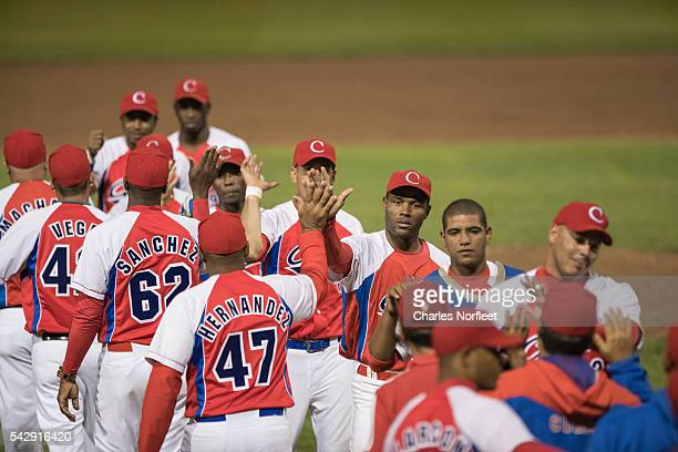Members of the Cuban National Team congratulate each other at the end of the game at Palisades Credit Union Park on June 24, 2016 in Pomona, New...
