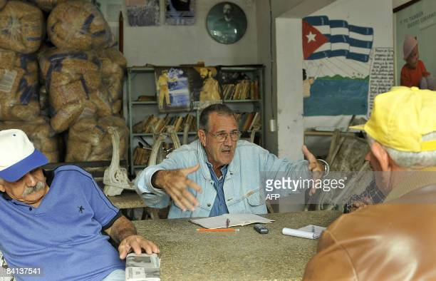 SPANISH Members of the Cuban Revolution Combatants Association Hubert Perez Arnaldo Gascon and Manuel Bustamante gather in the township of El Cotorro...