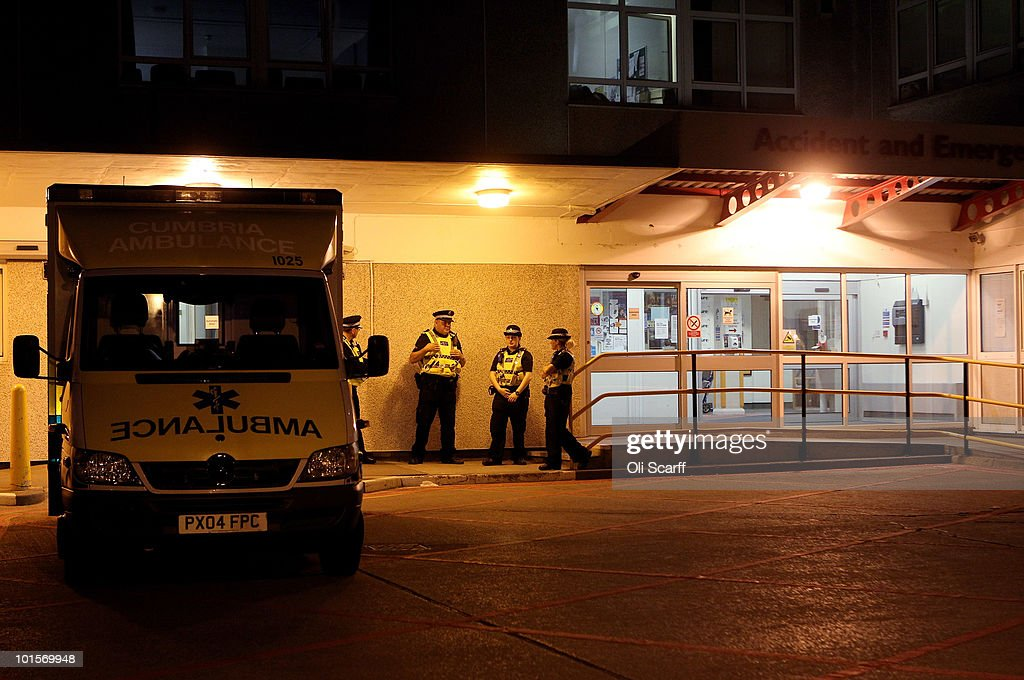 Members of the Cumbria Police Force stand guard at the entrance to the West Cumberland Hospital where members of the public are being treated for injuries caused by gunman Derrick Bird on June 2, 2010 in Whitehaven, England. 12 people have been shot dead and a further 25 people injured after a 52 year old man named as Derrick Bird went on a rampage with a shotgun in Cumbria before killing himself.