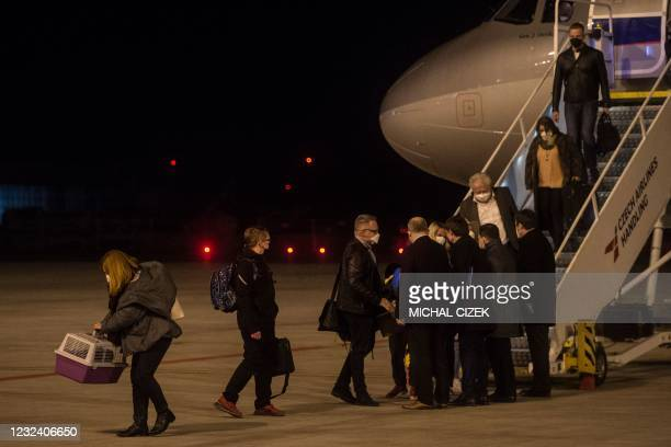 Members of the Czech Embassy in Russia arrive at Vaclav Havel airport on April 19, 2021 in Prague, two days after the Czech Republic announced that...