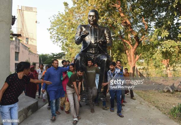 Members of the Dalit Shakti Kendra carry a fibreglass statue of Indian jurist and social reformer BR Ambedkar at Nani Devti village some 40 km from...