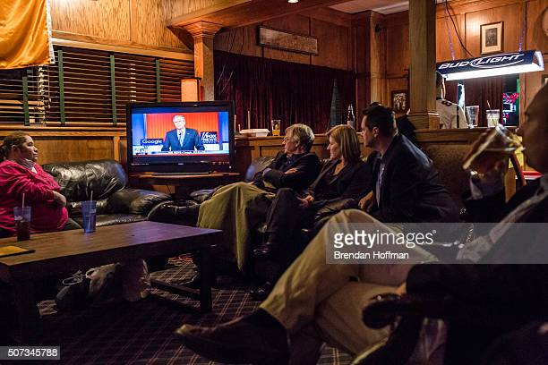 Members of the Dallas County GOP watch the Republican presidential debate at Mickey's Irish Pub on January 28 2016 in Waukee Iowa The Democratic and...