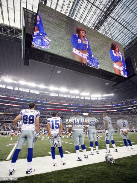 Members of the Dallas Cowboys stand on the sidelines during the National Anthem of a preseason game against the Tennessee Titans at Dallas Cowboys...