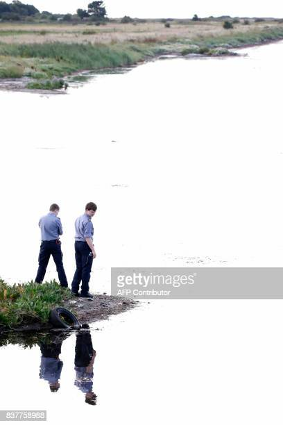 Members of The Danish Emergency Management Agency assist police at Kalvebod Faelled in Copenhagen on August 23 2017 in search of missing bodyparts of...