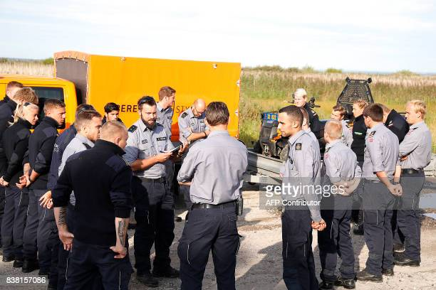 Members of the Danish Emergency Management Agency prepare to assist the police at Kalvebod Faelled near Copenhagen on August 24 in search of the...