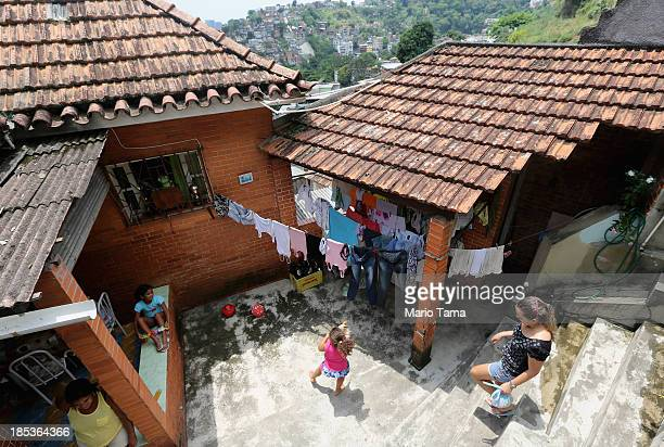 Members of the Das Neves family gather in their home in the Prazeres favela on October 19, 2013 in Rio de Janeiro, Brazil. The family participates in...