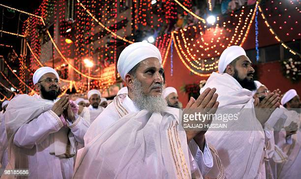 Members of the Dawood Bohra community gesture as they seek blessings from their unseen spiritual leader Syedna Mohammed Burhanuddin on the ocassion...
