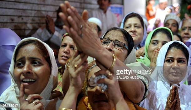 Members of the Dawood Bohra community gesture as they seek blessings from their unseen spiritual leader Syedna Mohammed Burhanuddin on the occasion...