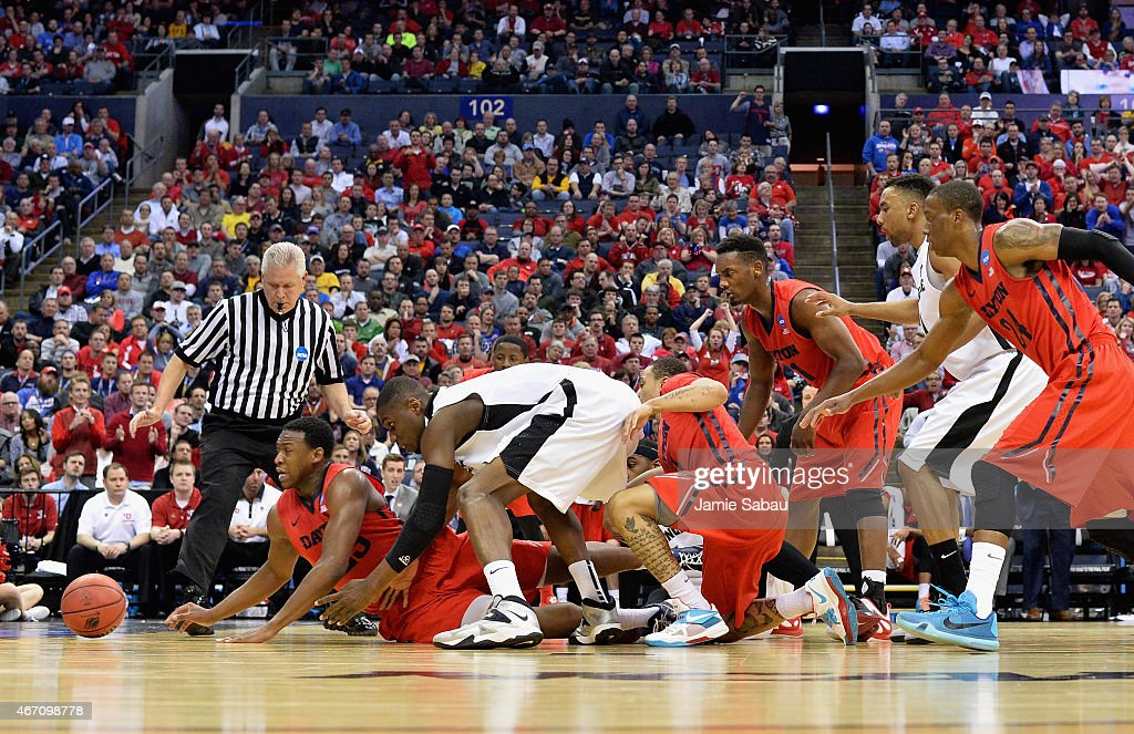 Members of the Dayton Flyers and Providence Friars go after the ball in the first half during the second round of the 2015 NCAA Men's Basketball Tournament at Nationwide Arena on March 20, 2015 in Columbus, Ohio.