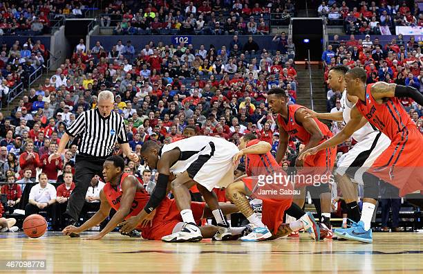 Members of the Dayton Flyers and Providence Friars go after the ball in the first half during the second round of the 2015 NCAA Men's Basketball...