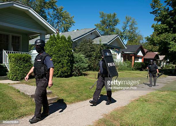 Members of the Dayton Police Department Drug Enforcement Unit walk out of a home that was searched for Heroin on Walton Ave on September 15 2015 in...