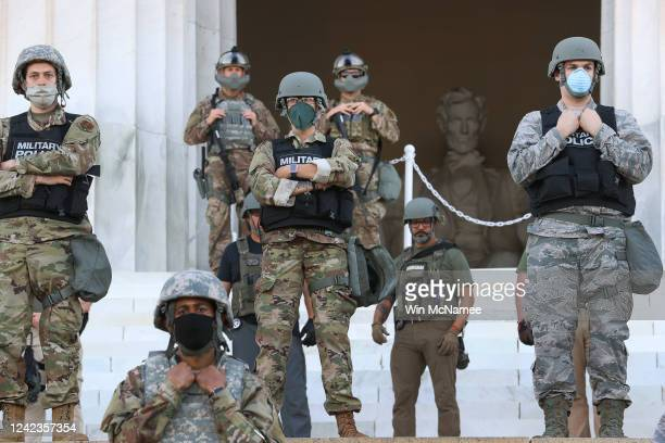 Members of the DC National Guard stand on the steps of the Lincoln Memorial monitoring demonstrators during a peaceful protest against police...