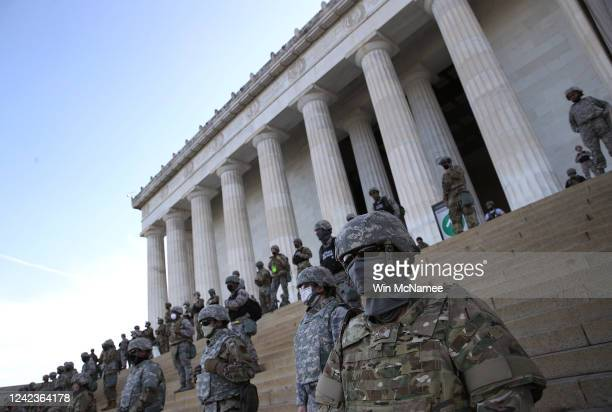 Members of the DC National Guard stand on the steps of the Lincoln Memorial as demonstrators participate in a peaceful protest against police...