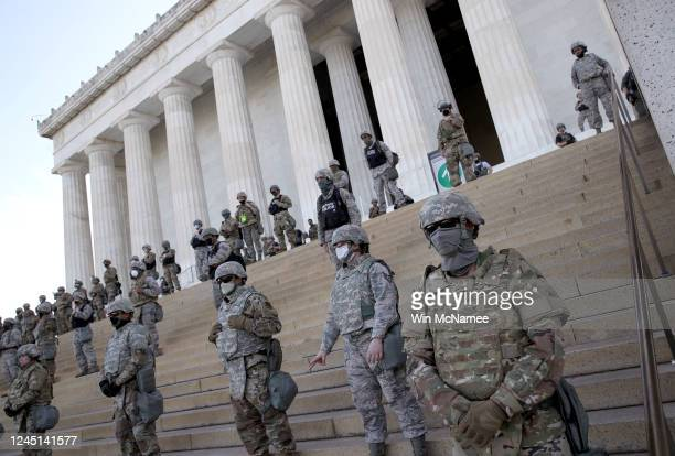 Members of the D.C. National Guard stand on the steps of the Lincoln Memorial as demonstrators participate in a peaceful protest against police...