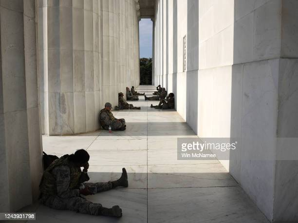Members of the D.C. National Guard take advantage of the shade at the Lincoln Memorial as demonstrators citywide participate in peaceful protest...