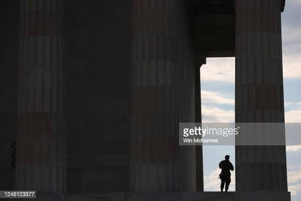 Members of the DC National Guard take advantage of the shade at the Lincoln Memorial as demonstrators citywide participate in peaceful protest...