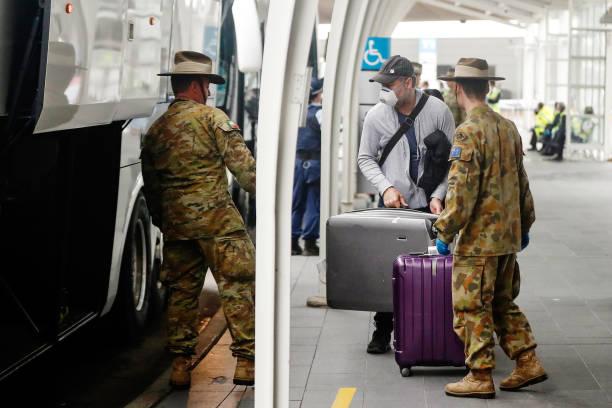 AUS: International Travellers Arrive To Mandatory Isolation Orders In Sydney