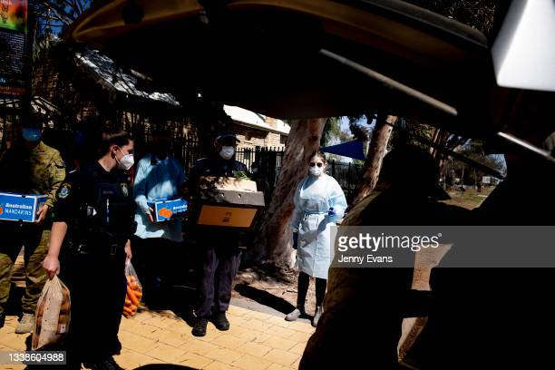 Members of the Defense Force, Police Force and Sarah Donnelley help load cars with food and supplies on September 06, 2021 in Wilcannia, Australia....