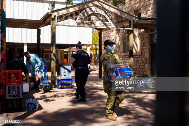 Members of the Defense Force, Police Force and volunteers help load cars with food and supplies on September 06, 2021 in Wilcannia, Australia. After...
