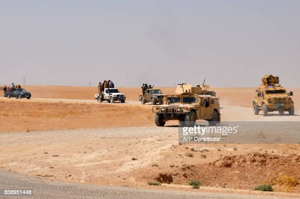Members of the Deir Ezzor Military Council a coalition of Arab tribes and fighters that belongs to the broader USbacked Syrian Democratic Forces ride...