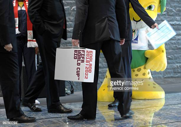Members of the delegation holds the England 2018 and 2022 World Cup bid books close to Zakumi the FIFA 2010 World Cup mascot prior to an official...